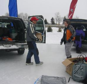 Arrived at the Kite Camp early in the morning Feb 19, 2005. Brent, Andrew and Jim in the background were unloading the equipment (Note that the trucks are on ice. Yes, the ice is thick enough to support trucks this time of the year in Canada)